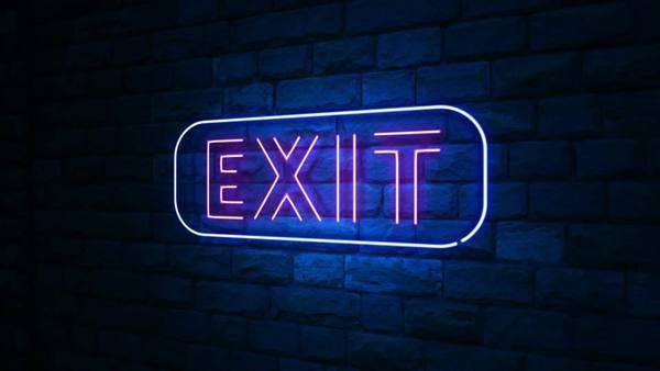 Animation of exit neon light sign at urban wall in the night with