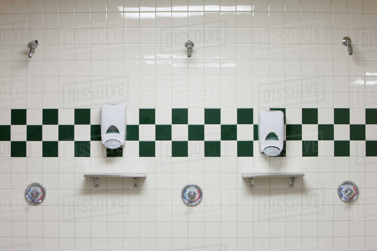 Bathroom Shower Dispensers Public Shower Room With Soap Dispensers On Wall Stock Photo