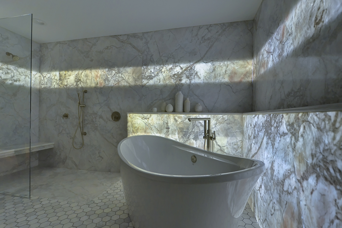 A Backlit Marble Wall Gives This Guest Bath Its Wow Factor Remodeling