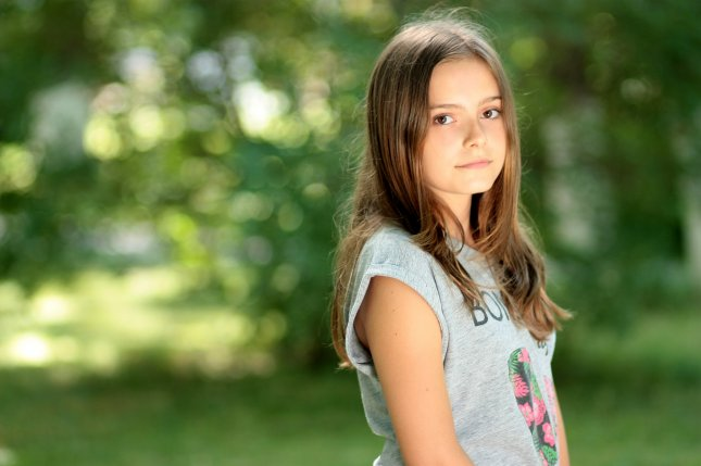 Study Early puberty in girls may take mental health toll - UPI