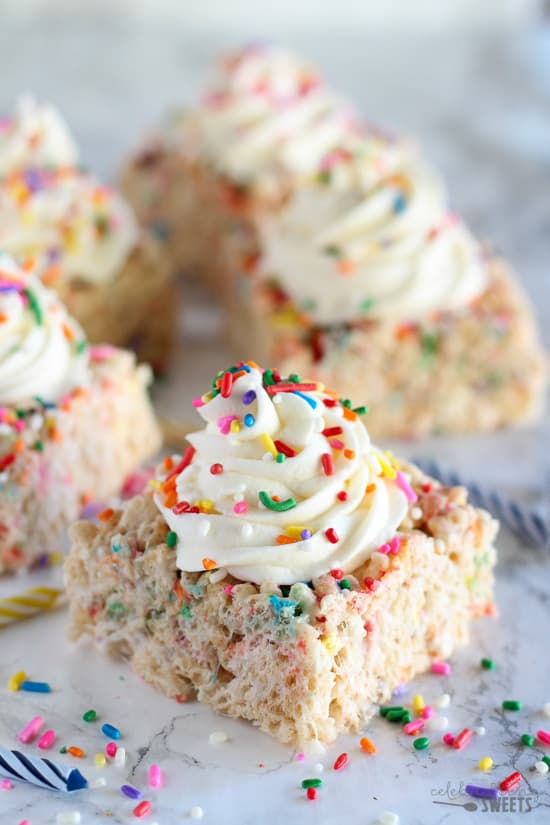 Birthday Sprinkle Rice Krispies Treats - Chewy, gooey rice krispie treats filled with colored sprinkles, decorated with vanilla frosting and topped with more sprinkles! Perfect for birthday parties and celebrations!