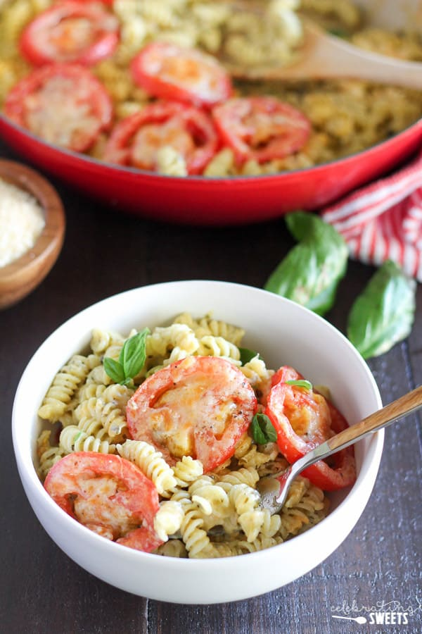 Pesto Macaroni and Cheese - An easy and flavorful one-pot meal of macaroni and cheese with the addition of basil pesto and a parmesan tomato topping.
