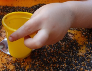 sensory play birdseed yellow