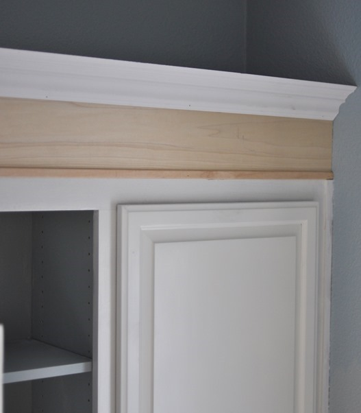 Painted bathroom cabinets centsational girl for Can you add molding to kitchen cabinets