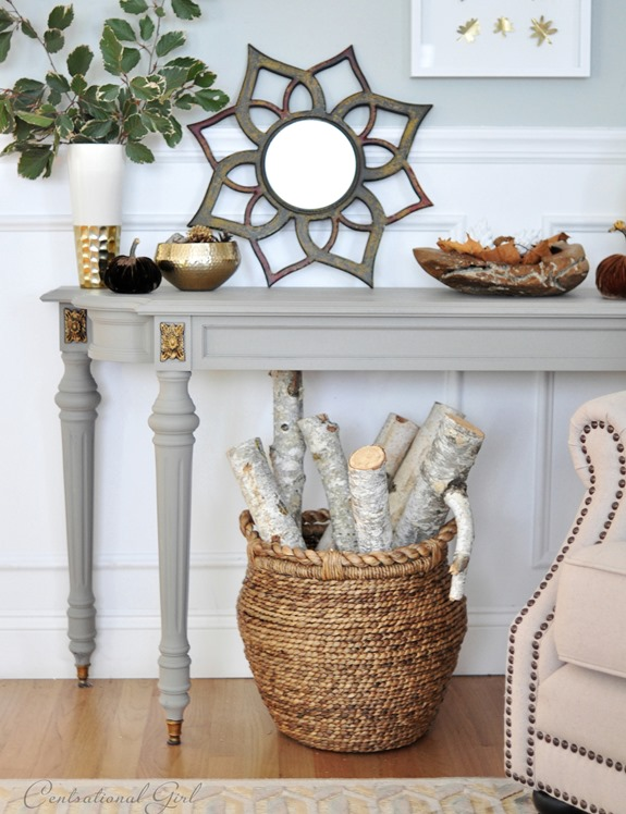 basket of logs under gray console