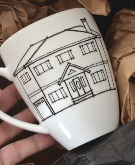 mug with sketch of house