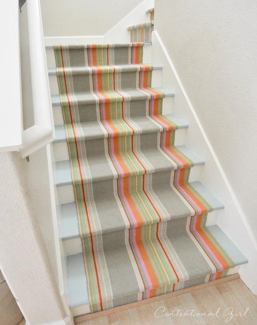 striped runner on painted staircase