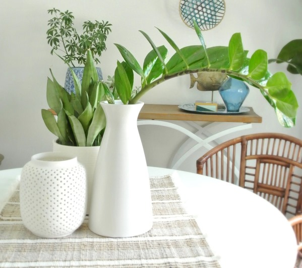 white vases on table