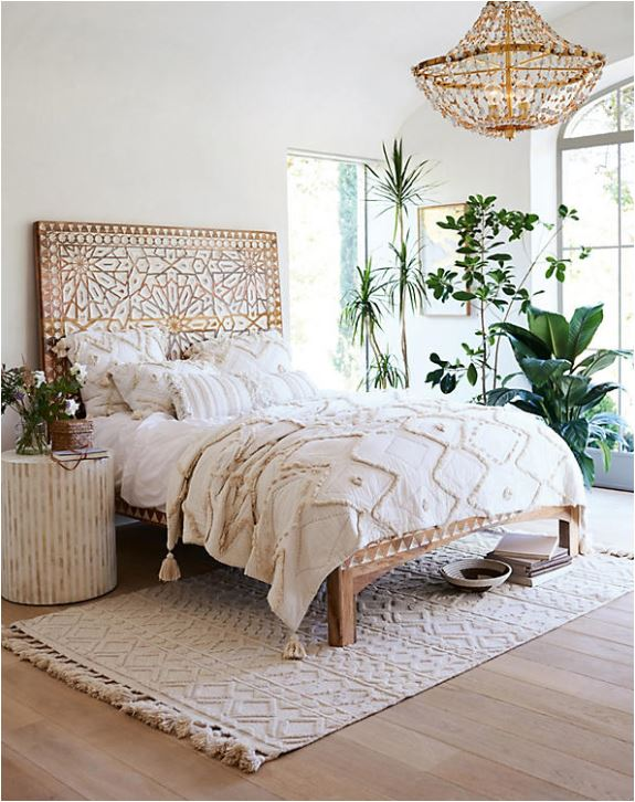 Layering rugs under beds centsational girl for What size rug under king bed