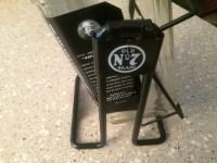 Jack Daniels bottle and bottle holder | Collectors Weekly