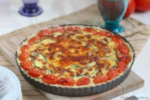 Cheesy zucchini tart with pine nuts and grape tomatoes