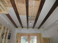 I want to do an exposed floor joist ceiling, painted black ...