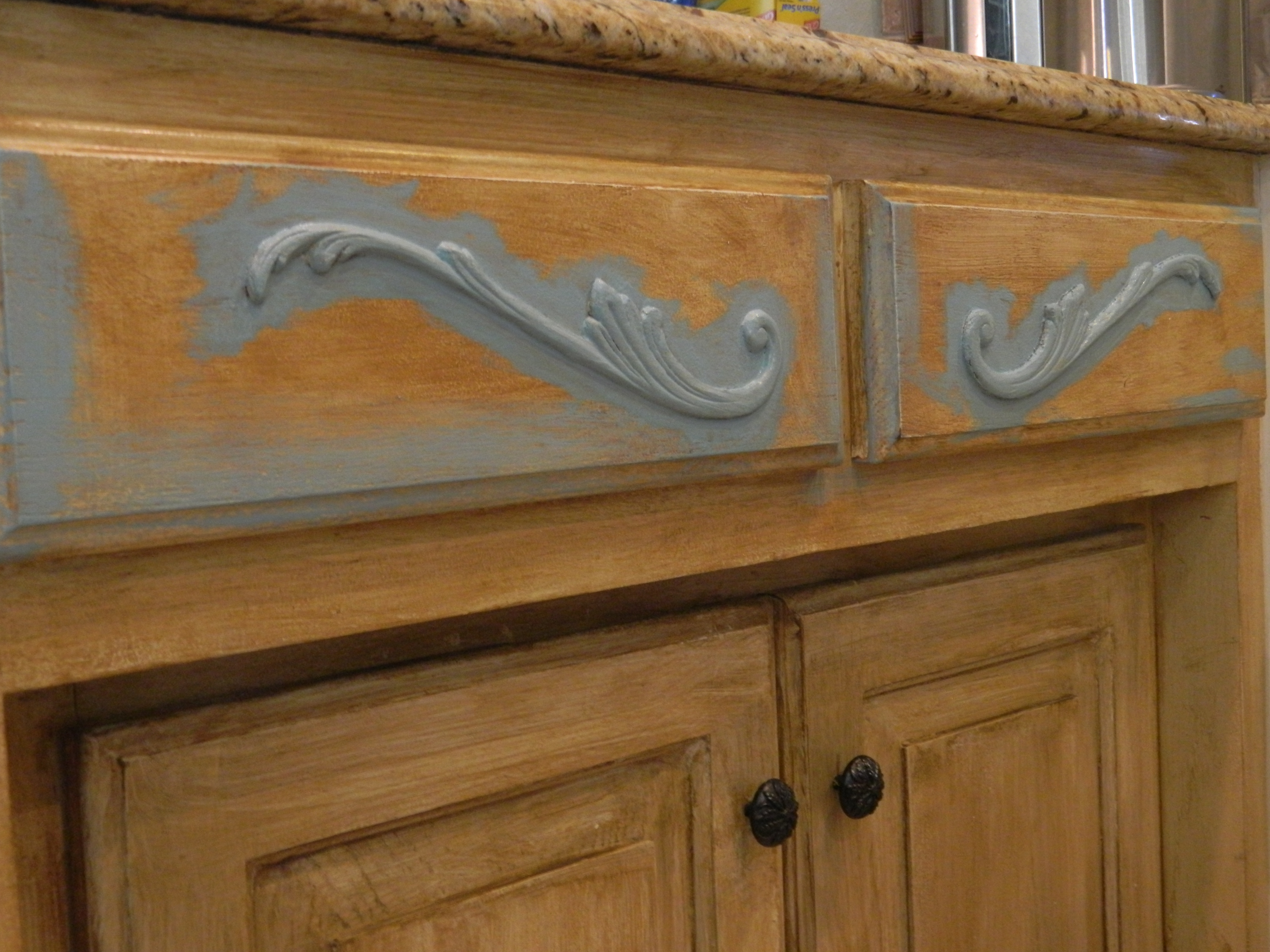 plain cabinets updated with architectural details kitchen cabinet updates Need an easy and relatively inexpensive way to update your plain builders grade cabinets architectural details and paint can add a distinctive touch to