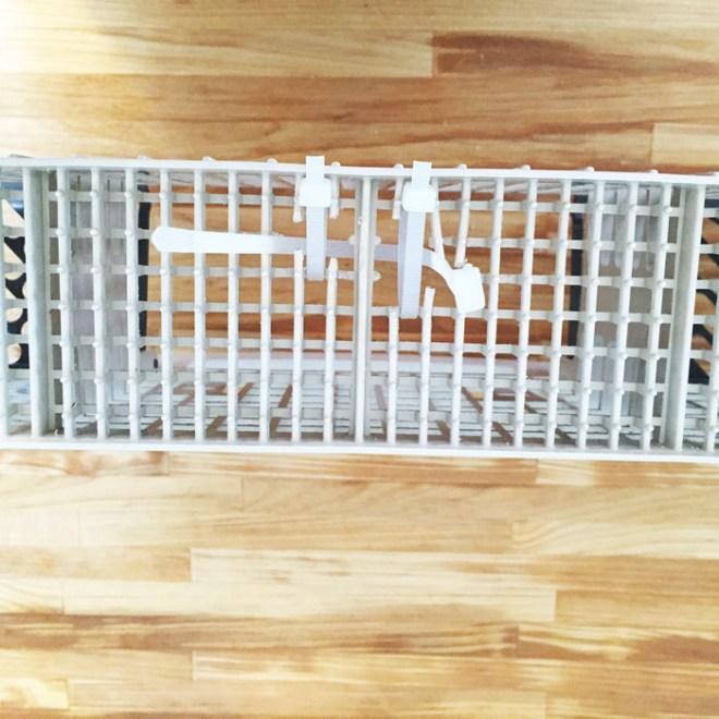 Photo showing the zip ties weaved between the broken slats of the