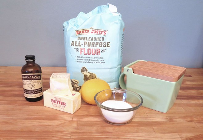 the ingredients needed for meyer lemon shortbread: flour, sugar, salt, butter, vanilla, one lemon.
