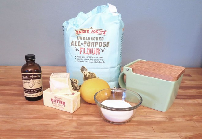 the ingredients needed for meyer lemon shortbread: flour, sugar, salt, butter, vanilla, one lemon.