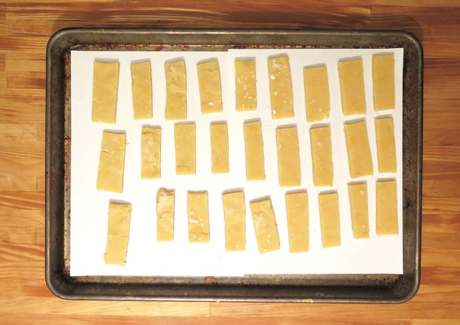 Un-baked shortbread cookies arranged on a baking sheet.