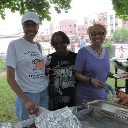 Bessie Ware, Gay Johnson and Novela Pittman fix their plates at the seniors' picnic.