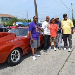 "Geneva ""Gee Wiz"" Williams (third from right) posed with her record-setting 1968 Camaro with (from left) GCREC board member Don Newton; her brother, Emerson ""The Wiz"" Williams, Jr., show co-sponsor Charlie Washington, and GCREC President James Harper."