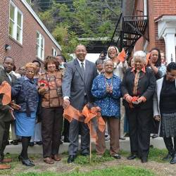 Local government officials joined club and organization officials in cutting the ceremonial ribbon on the newly renovated historic properties.