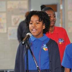 A student at Chester Community Charter School (CCCS) performs at the school's recent Behavior Behind the Music Youth Summit event, where more than 800 students gathered to discuss the importance and influence of music with professional music panelists.