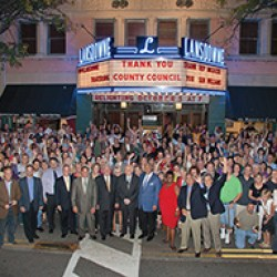 County leaders and community officials and residents turned out for this promotional photograph commemorating the relighting of the theatre's marquee
