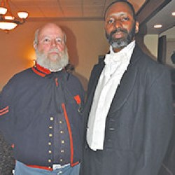 Keith Foote, dressed as a captain of a Civil War battery, stands with Antoine Watts who was depicting Jacob C. White, Jr., Philadelphia's only African-American principal and teacher in 1864.