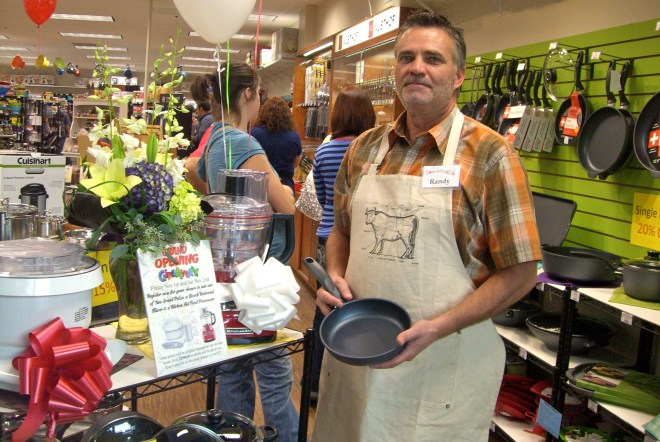 Randy Anderson welcomes shoppers to his Love To Cook store at the Newgate Mall in Ogden.