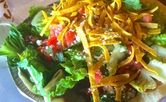 Cafe Ro's Spicy Green Chile Pork in a salad.