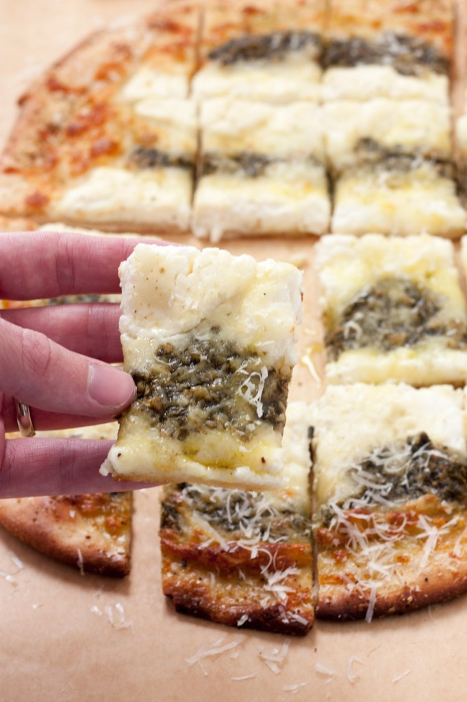 Ricotta and Pesto Pizza - With the help of some store bought ingredients, you can pull this pizza out of the oven on the busiest of weeknights or a weekend date night in.