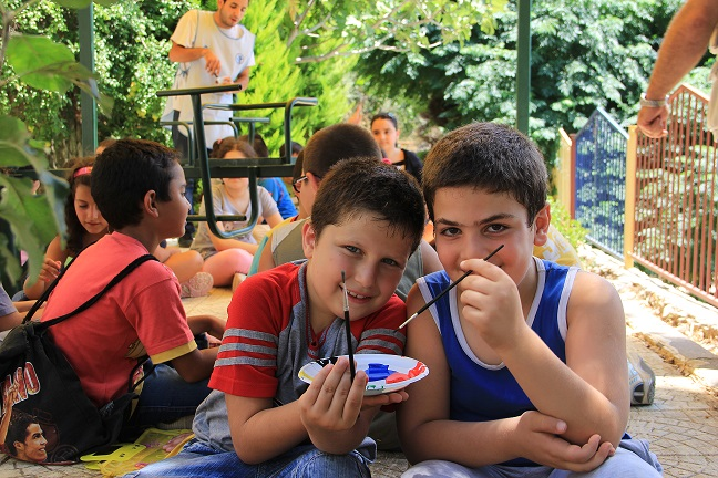 Conflict-displaced children take enjoy art activities at a UNICEF-supported centre in rural Tartous. © UNICEF Syria/2013/Hassoun