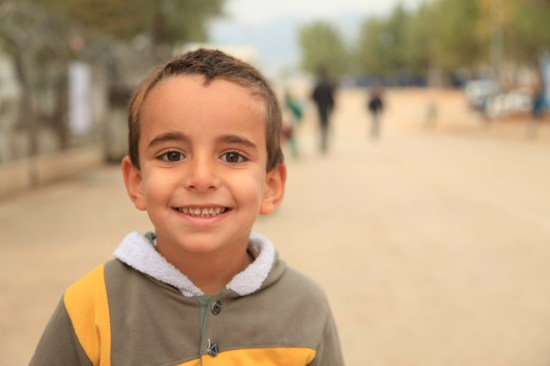 A boy outside school in Turkey's Islahiye camp