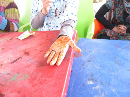 Bailasan, 12, shows her henna painted hand
