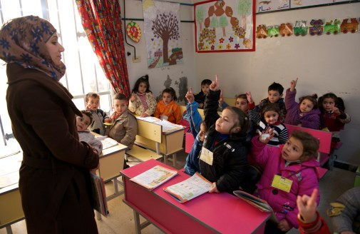 Children are eager to respond to a question from the teacher