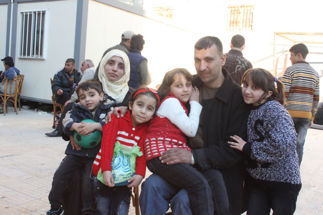 Abu Ibrahim is reunited with his family after being evacuated from Old Homs in early February. His wife and four children visit him at the Al Andalous detention facility where he is being processed by Syrian authorities.  ©UNICEF/Syria-2014/Rashidi