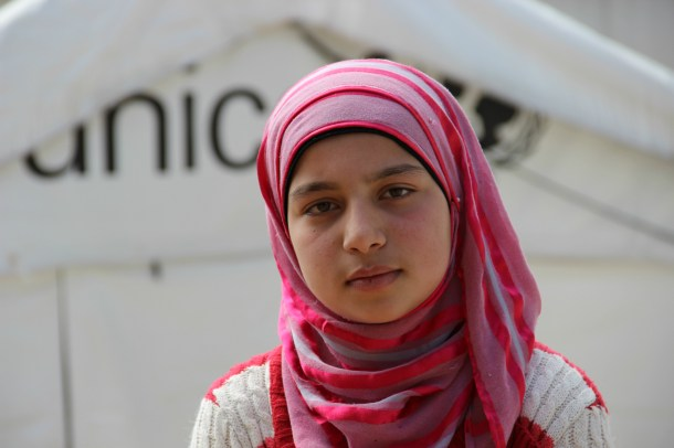 13-year old Ghader in front of a UNICEF tent
