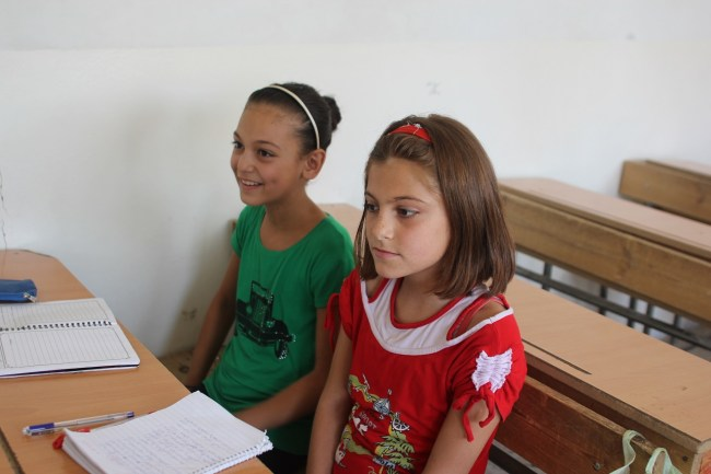 Lama (R), a fifth grader, attends the school club in Safi Al Dien Al Heli School three days a week. ©UNICEF/Syria-2014/Rashidi