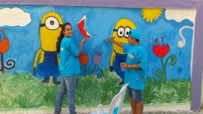 Adolescent volunteers painting the external perimeter wall of Akrama Al Muhdatha school. On 1 October 2014 at noon, a double bombing incident rocked a school neighborhood of Homs,  leading to mass casualties and injuries. The explosions occurred at the time when students were breaking for the day. Thirty children have been among the 50 killed in the incident. Over 2,500 students study in the two schools. ©UNICEF/Syria-2014/UNICEF Homs Staff