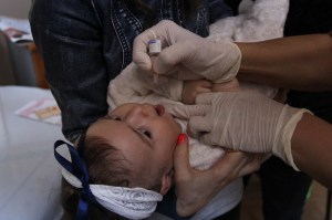 8-month-old Meryem receives a polio vaccination at the Fatih Imrahor Family Health Center in Istanbul, Turkey. @UNICEF/Turkey 2014/Yurtsever