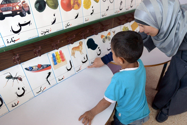 Syrian refugee children are taught basic literacy and numeracy skills in non-formal education programmes. ©UNICEF/Lebanon-2014/ Brooks