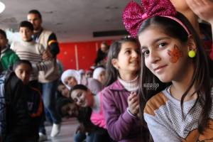 Lamia, 9, shows her face painting which she got a one of Aoun/UNICEF supported open day's activities sessions in Al Enshaat Area in Homs. This session reached 389 children including 209 girls   ©UNICEF/Syria/2015/ Aoun/Ghadeer Qara Bolad