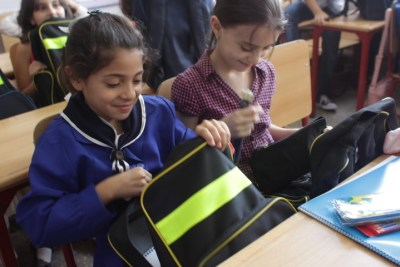 Fourth grade girl checking the content of her new school bag which was manufactured inside Syria. ©UNICEF/Syria/2015/Razan Rashidi