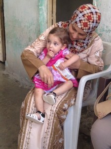 Pic 1©UNICEF Syria/2015/Saker- Farah with her mother Yasmine in their house in Al- Rteilieh village, rural Lattakia.