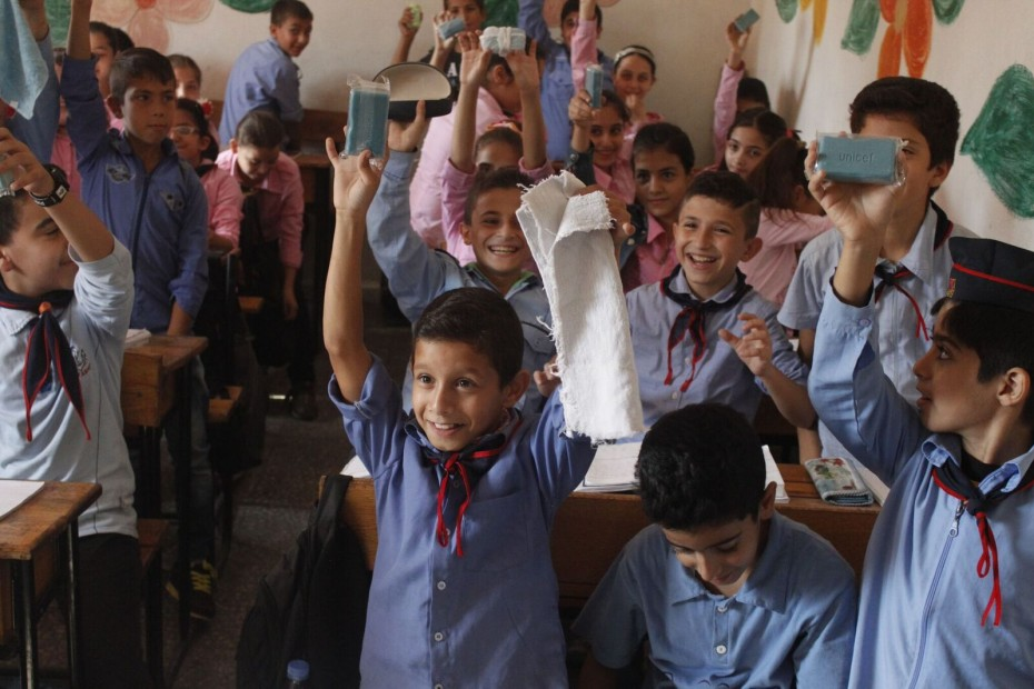 ©UNICEF/ Syria 2015/ Yasmine Saker. 6th graders Mudar and his classmates showing off their blue bars of soap, right after a hygiene promotion session on the importance of hand washing by our partner: Friends of the Poor Association.