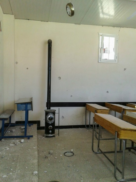 ©UNICEF/ Syria 2016 - Bullets penetrated the walls of the prefabricated classrooms provided by UNICEF at the 1070 school in Aleppo, as ongoing attacks and fighting have damaged 12 schools in the city.
