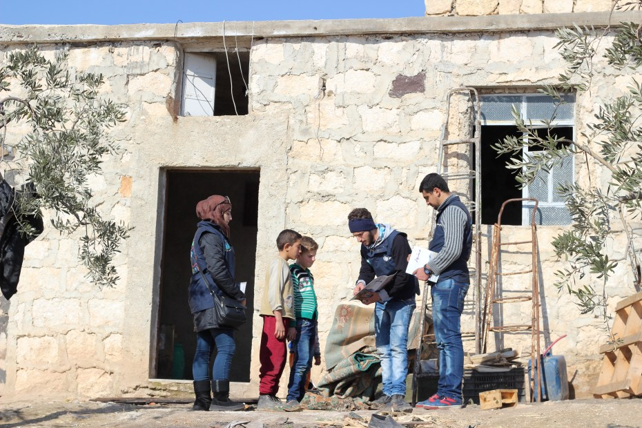 ©UNICEF/Syria/2017/Al-Issa UNICEF-supported volunteers on a home visit to Amin's family in Assan village, southern rural Aleppo. Volunteers hold awareness sessions and recreational activities to educate children and parents on the life-threatening risks of remnants of war.