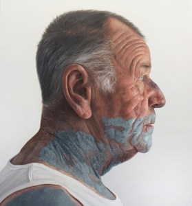 'Man with green paint on face' by Kyle Barnes