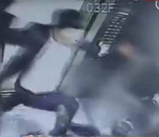 man beating woman