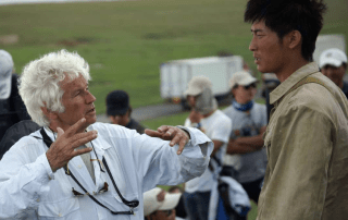 Jean Jacques Annaud and Shawn Dou on set in Inner Mongolia.