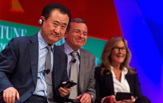 Dalian Wanda Group CEO Wang Jianlin (foreground) at the Fortune Global Forum 2013 with Disney CEO Bob Iger and then CEO of Burberry, Anglea Ahdrendts. (Creative Commons—Stephen Chow).